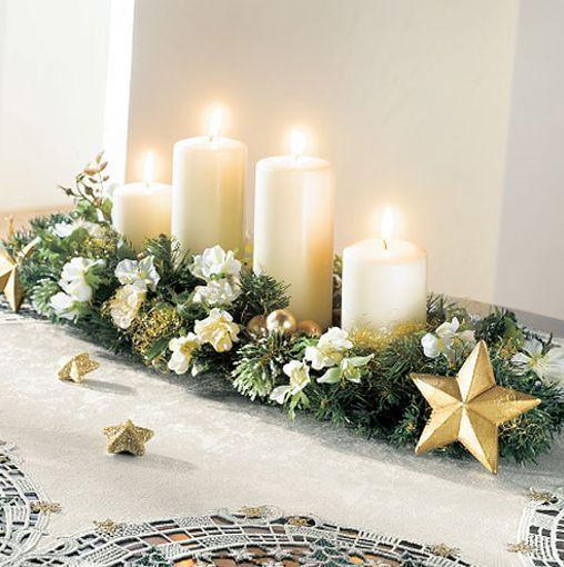 Decoración centro de mesa con velas blancas