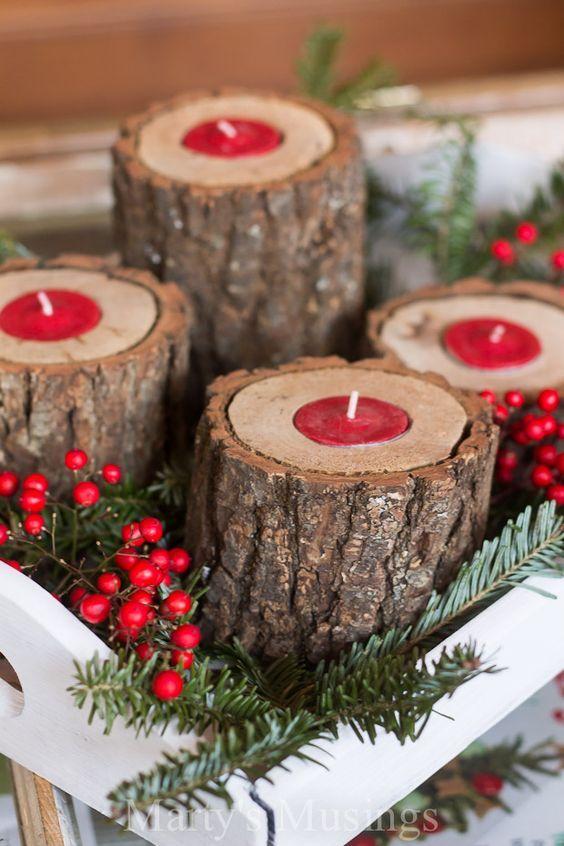 Velas de Navidad en troncos de madera